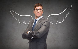 Businessman with angel wings over gray Royalty Free Stock Image