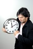 Businessman angry the clock Royalty Free Stock Photo