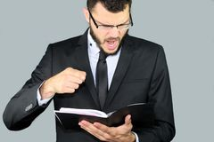 Businessman angry. Businessman complains that the schedule is incorrect stock photography