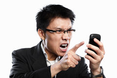 Businessman angry expression when using video call Royalty Free Stock Photography