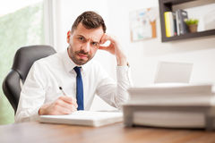 Businessman angry and overwhelmed with work Royalty Free Stock Images