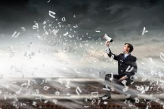 Businessman announcing something Stock Image