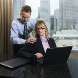 Businessman Annoying Businesswoman Stock Photo