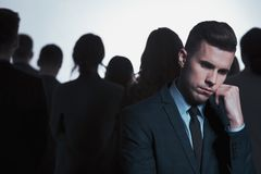 Businessman and anonymous crowd Stock Photography