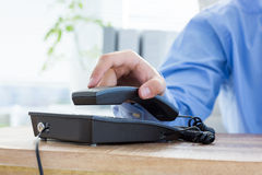 Businessman answer the phone Stock Photo
