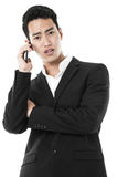 Businessman answering a call Royalty Free Stock Images
