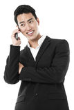 Businessman answering a call Stock Photo