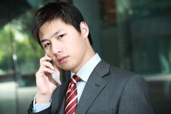 Businessman  is answering phone Royalty Free Stock Photography