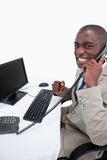 A businessman answering the phone Royalty Free Stock Image