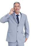 Businessman answering phone Stock Image