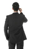 Businessman answering a phone call Royalty Free Stock Images
