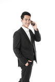 Businessman answering a phone call Royalty Free Stock Photo