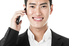 Businessman answering a phone call Stock Photography
