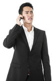 Businessman answering a phone call Royalty Free Stock Photography