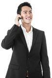 Businessman answering a phone call Stock Images