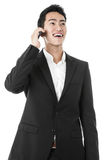 Businessman answering a phone call Royalty Free Stock Image