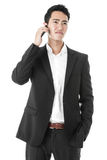 Businessman answering a phone call Stock Photos