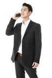 Businessman answering a phone call Stock Image