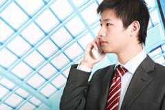 Businessman  is answering phone outdoor Stock Images