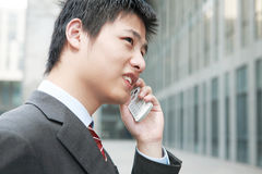 businessman  is answering phone outdoor Royalty Free Stock Photos