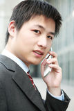 Businessman  is answering phone outdoor Royalty Free Stock Photography