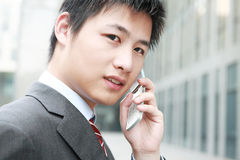 Businessman  is answering phone outdoor Stock Image