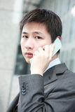 Businessman  is answering phone outdoor Stock Photo
