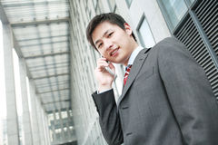 Businessman  is answering phone outdoor Royalty Free Stock Photo