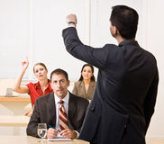 Businessman answering questions in meeting Stock Images