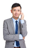 Businessman answering smart phone Royalty Free Stock Photo