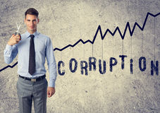 Businessman anti corruption. Cut corruption  - young businessman with scissors anti corruption Stock Images