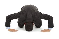 Businessman apologize with japanese kneeling position stock images