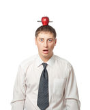 Businessman with apple on the head. Isolated on white half-length portrait Stock Photos