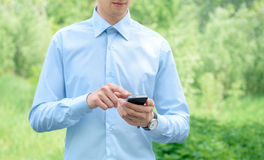 Businessman with Apple Iphone Royalty Free Stock Photos