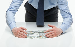 Businessman appropriating money Stock Images