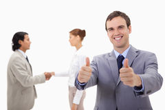 Businessman approving with hand shaking colleagues Stock Photos