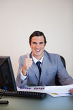 Businessman approving statistics Stock Images