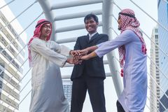 Businessman and Arab businessmen worker on construction site stock photos