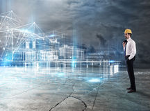 Businessman Architect analyzes a project of a building Stock Photography
