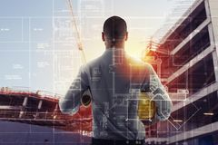 Businessman Architect analyzes the works of a building. double exposure royalty free stock photo