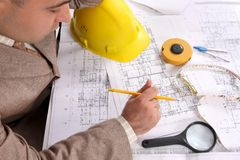 Businessman with architectural plans Royalty Free Stock Image