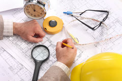 Businessman with architectural plans Royalty Free Stock Photo