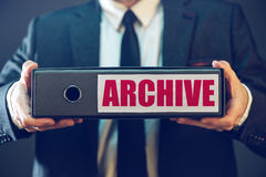 Businessman with archive files in document ring binder Royalty Free Stock Image