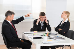 Businessman Arguing With His Two Co-workers Stock Photos