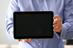 Businessman arm expose blank monitor of pc pad to camera closeup stock photography