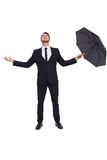 Businessman with arm out holding umbrella Royalty Free Stock Photos