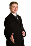 Businessman with arm out in a welcoming gesture , isolated on wh Royalty Free Stock Images