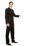 Businessman with arm out in a welcoming gesture Royalty Free Stock Images