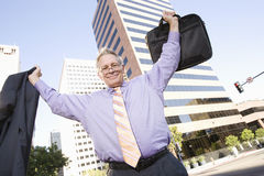 Businessman With Arm Raised Stock Photo