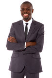 Businessman with arms crossed Stock Photography